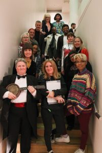 Ten Years of Queer Perspectives performers and curators! A group shot of the cast standing in one of the gallery stairwells