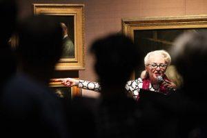 Bird la Bird pointing the finger. A long shot of Bird pointing to the painting of Babington Macaualy